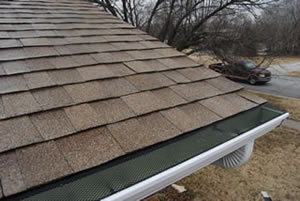 E-Z-Under gutter screens stand up under heavy debris and snow