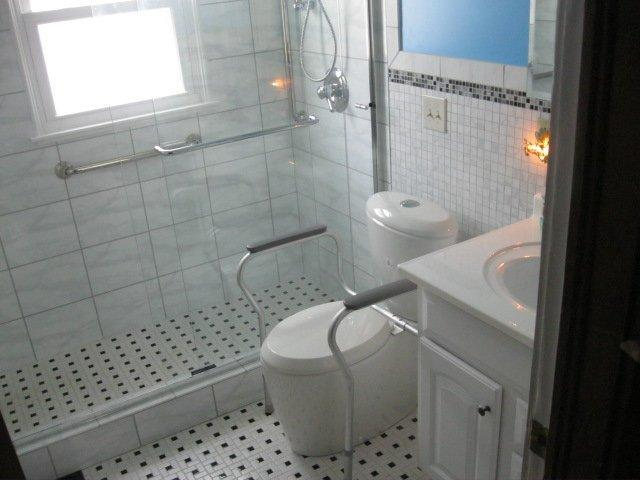 SA Construction Remodeling Showcase Bathrooms - Ada compliant bathroom tile